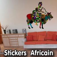 Stickers Afrique Rikou sur sa vache sacrée